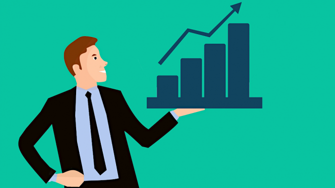 Man with a bar chart showing increasing sales