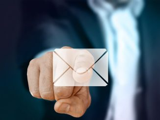 Businessman pointing to an email - clean up your Outlook email inbox