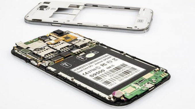 Inside a mobile phone showing the electronic components, many of which are valuable for recycling