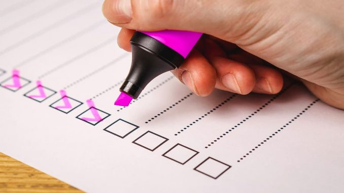Ticking off items on a checklist or to-do list with a marker pen