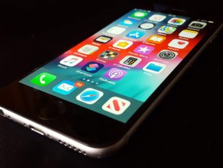 Close-up of the Apple iPhone showing the home screen