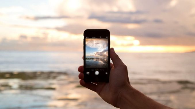 Taking a photo of a sunset with an iPhone