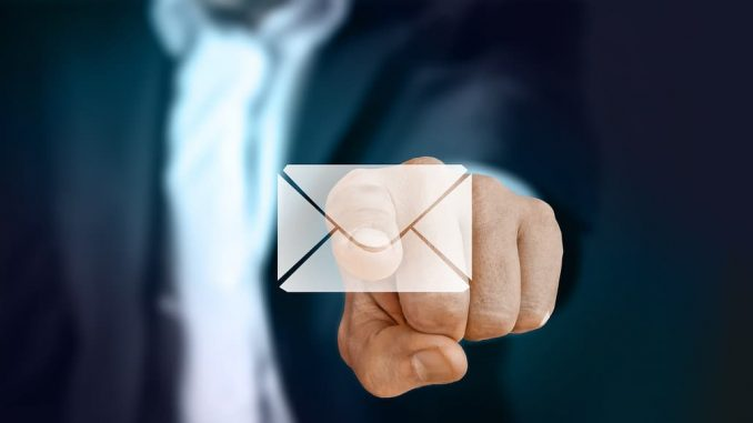 Hand pointing at mail. Beware of fake emails and phishing