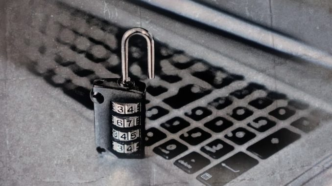Computer keyboard and padlock. Lock folders with controlled folder access