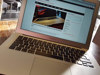 Apple MacBook being used in a cafe - don't leave it behind!