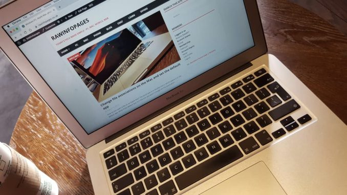 Apple MacBook Air on a table viewing a website