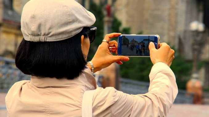 Woman taking a photo with a phone