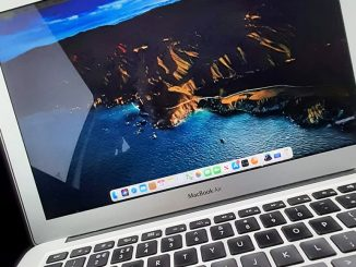 Close up photo of an Apple MacBook Air. Optimize it for speed