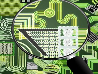 A computer circuit board and magnifying glass. Monitor what goes on inside the computer