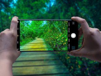 Smartphone camera taking a photograph