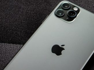 Apple iPhone showing the silver back and cameras