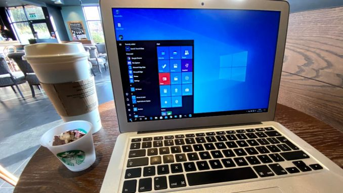 A laptop computer running Windows on a table in a cafe